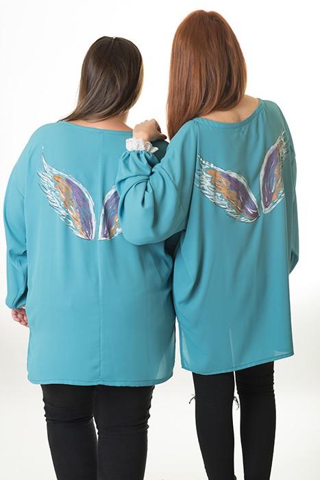 blusa-con-alas-en-espalda